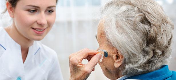 senior-inserting-hearing-aid-434584